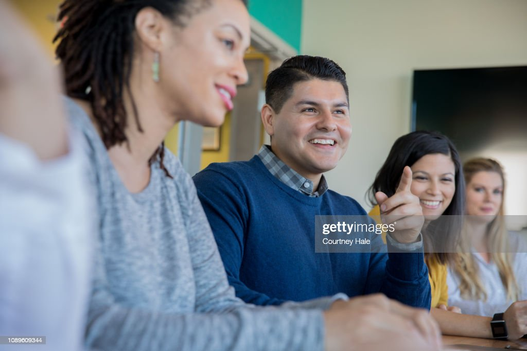 Creative professionals having training meeting in board room. : Stock Photo