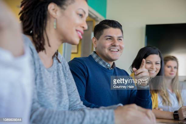 creative professionals having training meeting in board room. - casual clothing stock pictures, royalty-free photos & images