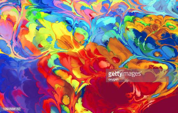 creative rainbow ebru background with abstract painted waves - psychedelic stock pictures, royalty-free photos & images