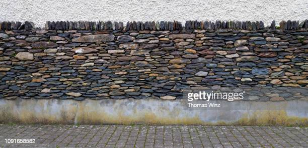 creative stone wall - stone wall stock pictures, royalty-free photos & images