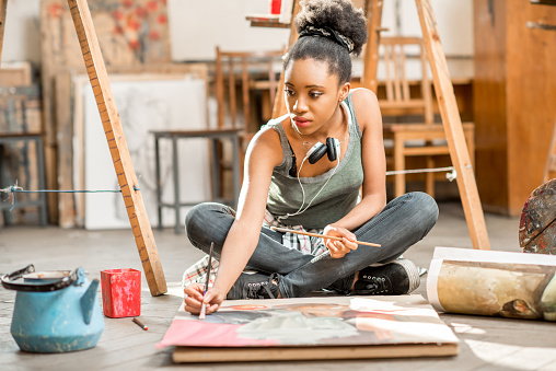 Creative student painting at the university 664785504