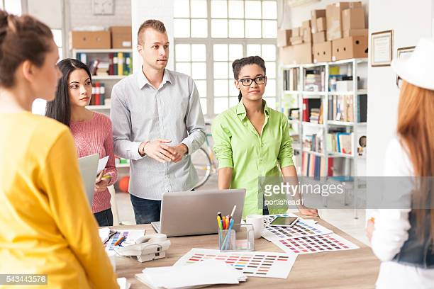Creative team discussing new project at workplace