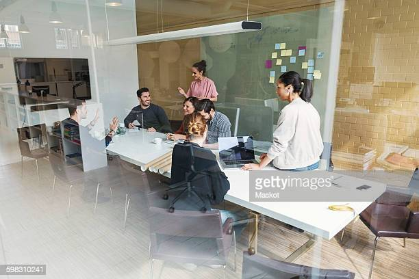 Creative team of business people having discussion in conference room