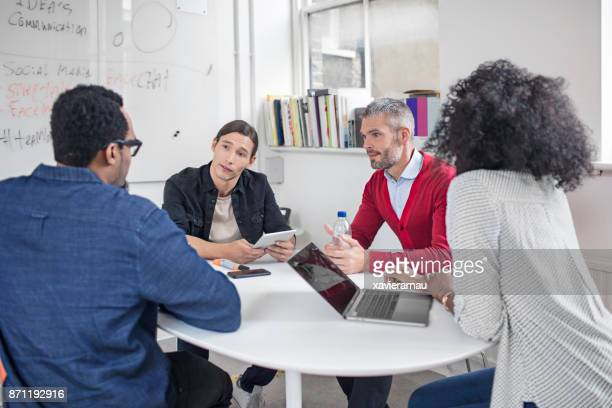 creative teamwork discussing about the new project - vanguardians stock pictures, royalty-free photos & images