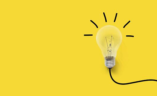 Creative thinking ideas brain innovation concept. Light bulb on yellow background 950216224