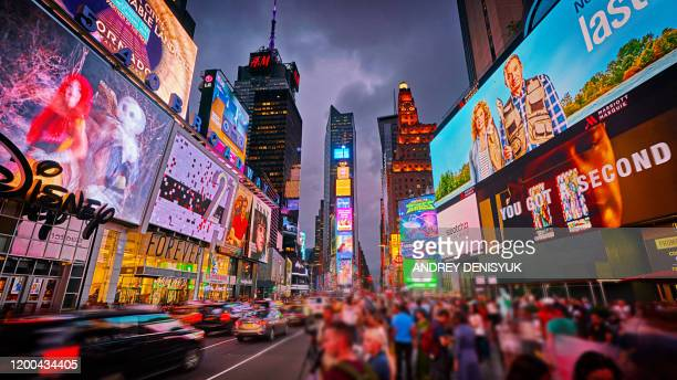 creative times square. advertising. billboard. crowd. tourist attraction - times square manhattan stock pictures, royalty-free photos & images