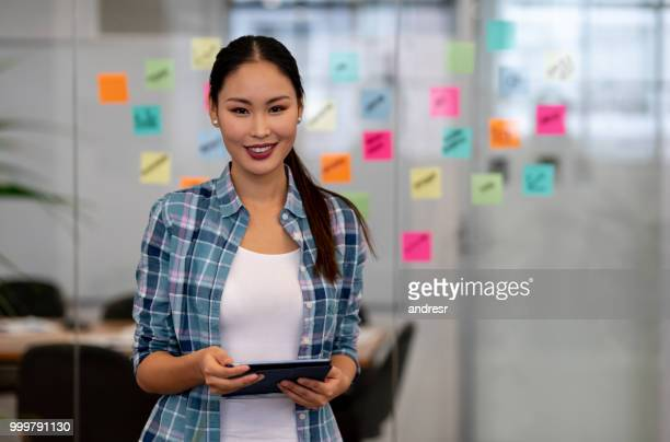 creative woman brainstorming at the office - business plan stock pictures, royalty-free photos & images