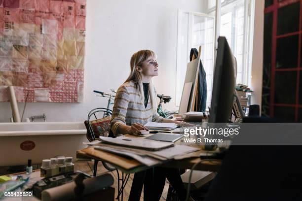 Creative woman looking at computer screen