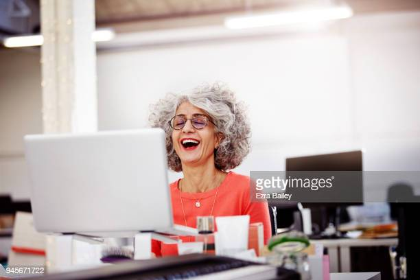 Creative woman working in an industrial office space.