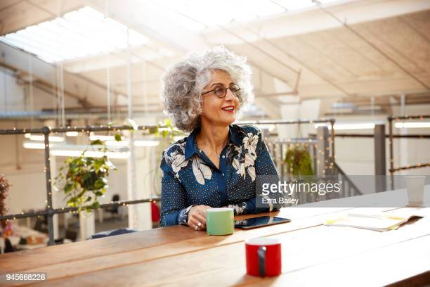 Creative woman working in industrial office space.