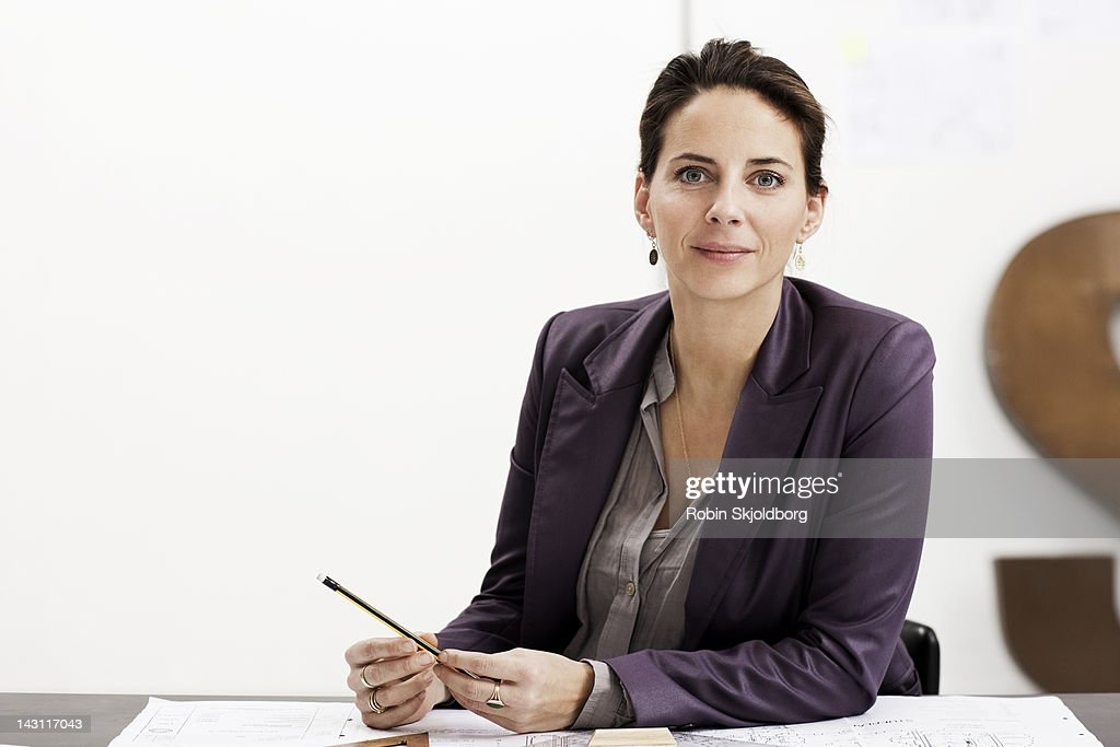 Creative young woman draws on sketch : Stock Photo