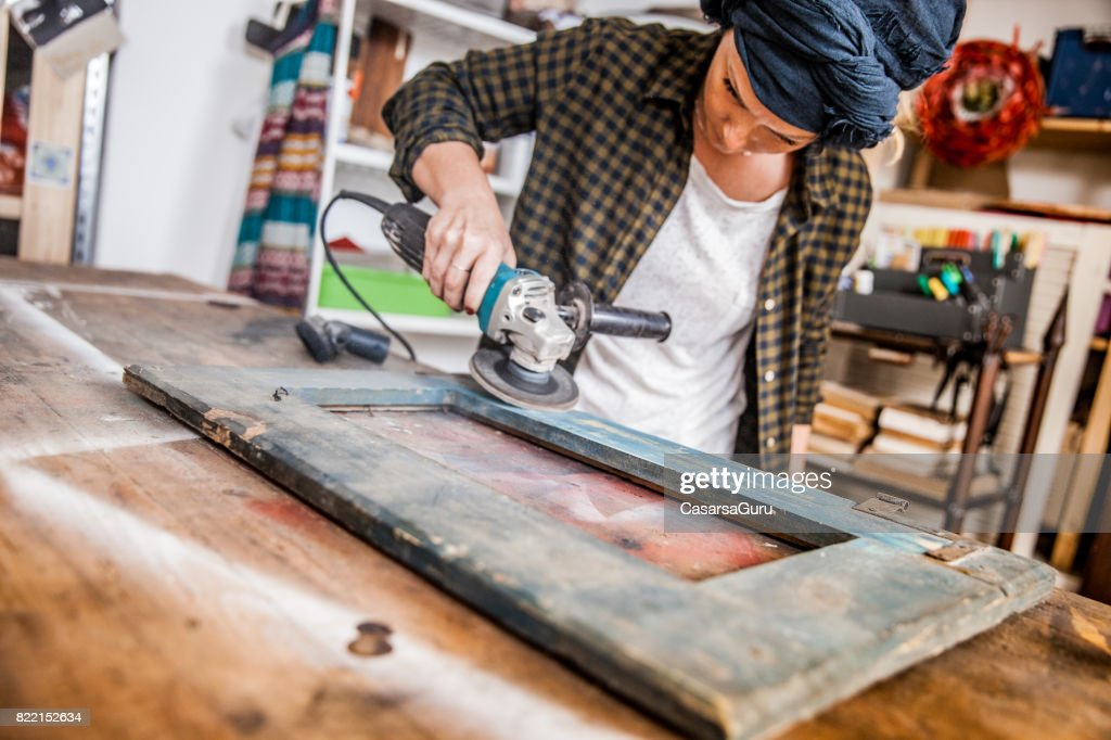 Creative Young Woman Restoring the Vintage Frame : Stock Photo