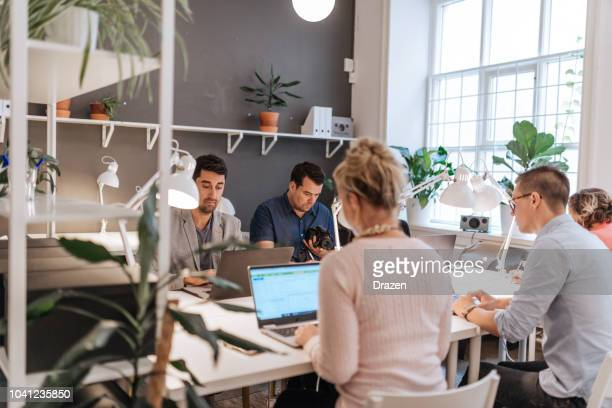 creativity and innovative approach in new start-ups - coworking stock photos and pictures