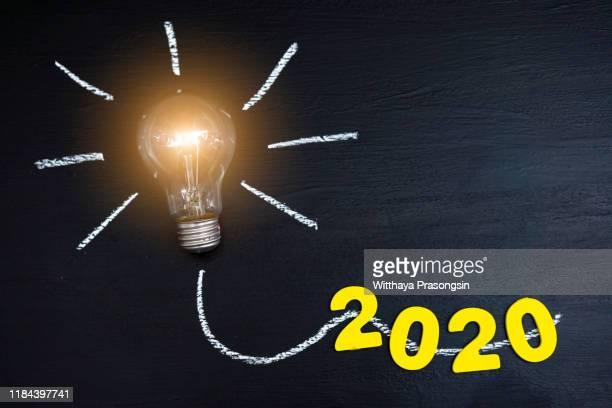 2020 creativity inspiration concepts with lightbulb - 2020 imagens e fotografias de stock