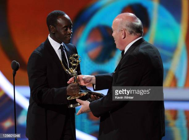 Creator Julian Fellowes accepts the Outstanding Miniseries or Made for Television Movie award from actor Don Cheadle onstage during the 63rd Annual...