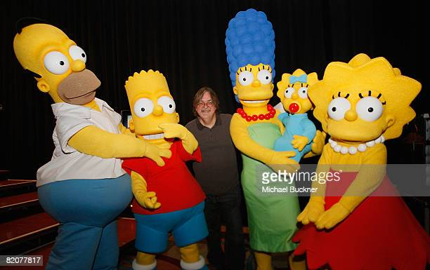 Creator Matt Groening poses with Simpson characters at 'The Simpsons' Panel during the 2008 Comic Con at the San Diego Convention Center on July 26...