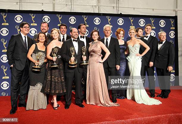 Creator Matthew Weiner and the cast and crew of Mad Men pose with their Emmy for Outstanding Drama Series in the press room at the 61st Primetime...