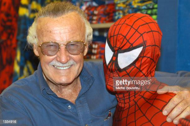 Creator Stan Lee poses with SpiderMan during the SpiderMan 40th Birthday celebration at Universal Studios on August 13 2002 in Universal City...