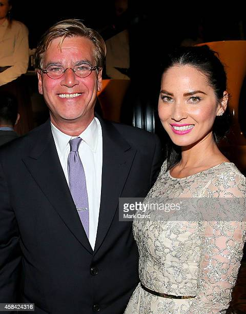 Creator/executive producer Aaron Sorkin and actress Olivia Munn attend the premiere of HBO's The Newsroom Season 3 at Directors Guild Of America on...