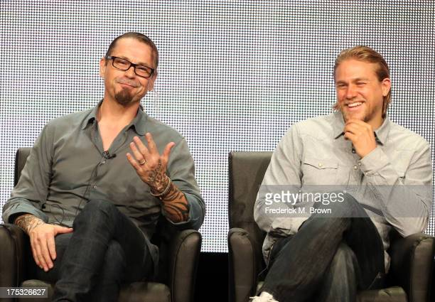 "Creator/Executive Producer Kurt Sutter and actor Charlie Hunnam speak onstage during the ""Sons of Anarchy"" panel discussion at the FX portion of the..."