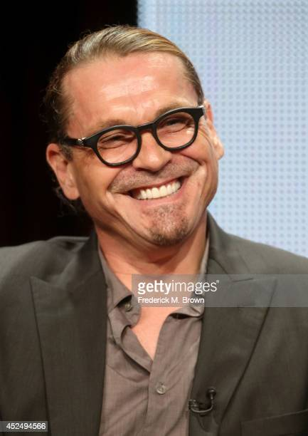 Creator/executive producer Kurt Sutter speaks onstage at the 'Sons of Anarchy' panel during the FX Networks portion of the 2014 Summer Television...