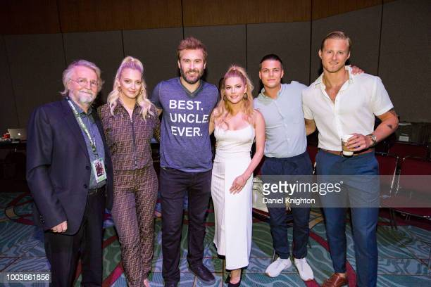 Creator/writer Michael Hirst actors Georgia Hirst Clive Standen Katheryn Winnick Alex Hogh Andersen and Alexander Ludwig of Vikings pose backstage...