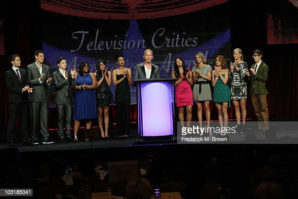"""Creator/writer Ryan Murphy with castmembers of """"Glee"""" accepts the award for """"Program of the Year"""" for """"Glee"""" onstage during the 26th Annual..."""