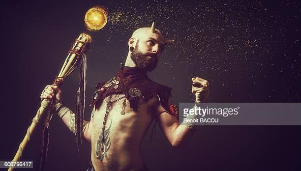 Creature holding a magic stick