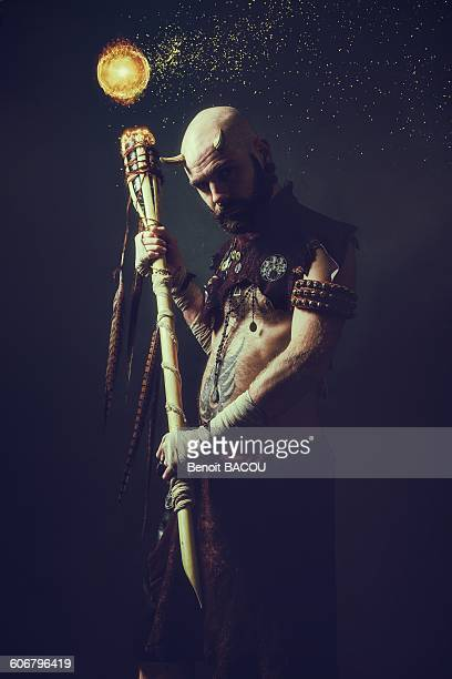 creature holding a magic stick - scepter stock pictures, royalty-free photos & images