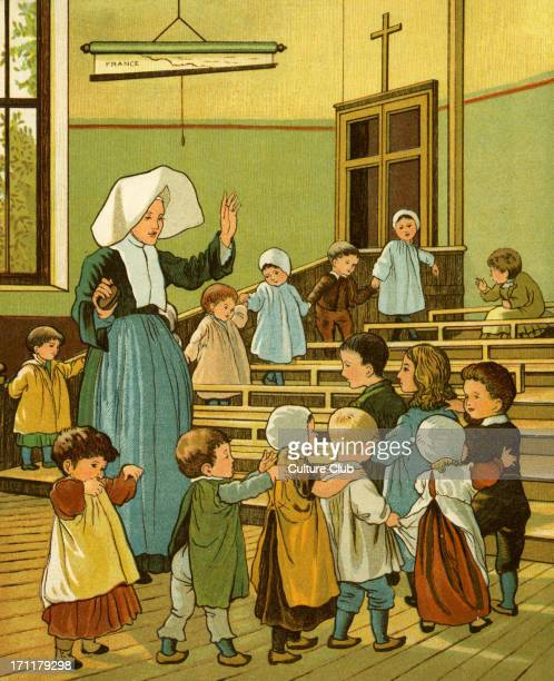 Creche of Sister Rosalie / Soeur Rosalie in Rouen France Nursery school run by nuns for working mothers Children dancing in a line and singing By...