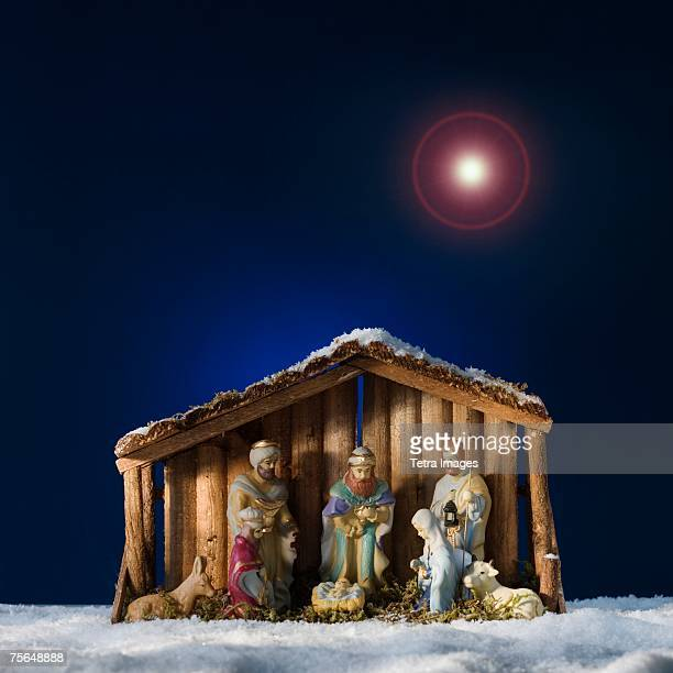 creche under star in sky - manger stock photos and pictures