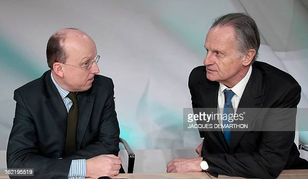Credit Agricole SA banking group chairman of the board Jean-Marie Sander speaks with CFO Bernard Delpit on February 20, 2013 in Montrouge, outside...