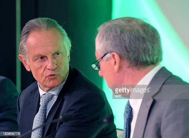 Credit Agricole SA banking group chief executive Jean-Paul Chifflet and chairman of the board Jean-Marie Sander talk together at the bank's...