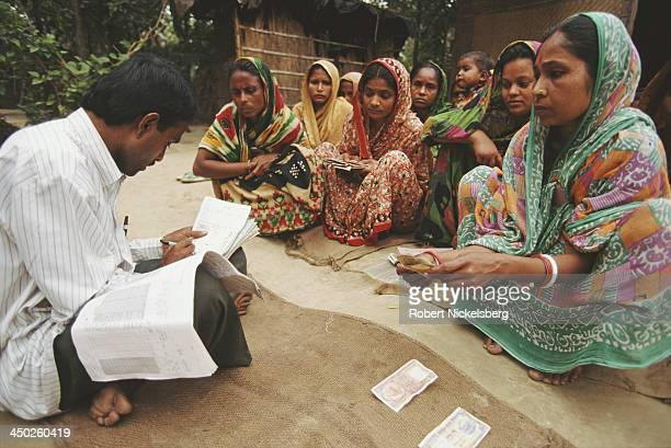 Credit borrowers in Mymensingh pay back their loans to the lender Bangladesh circa 1991