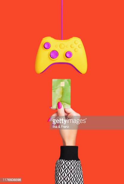 credit card and games controller - {{ collectponotification.cta }} stock pictures, royalty-free photos & images