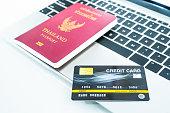 passport credit card keyboard traveling concept