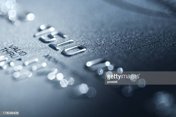 credit card detail photo focused on raised printed numbers - passport stamp stock photos and pictures