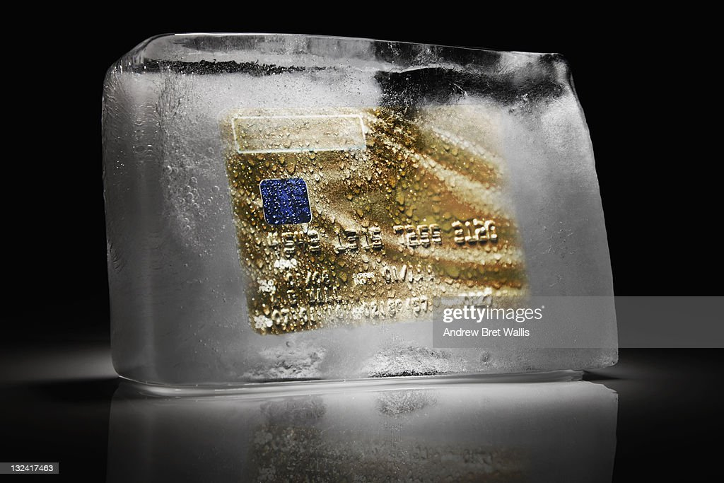 Credit card frozen inside a block of ice : Stock Photo