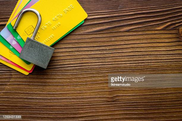 credit card hacked open lock wooden
