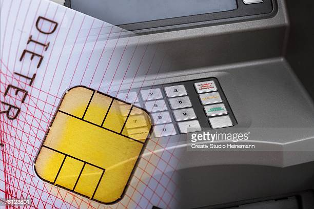 Credit card in front of cash terminal, close-up