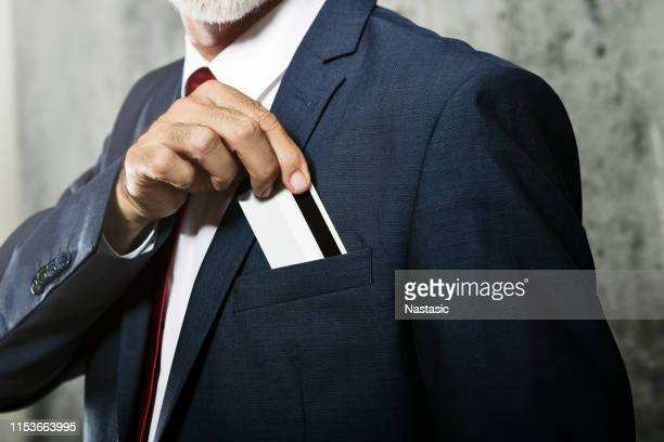 credit card in pocket - pocket stock photos and pictures
