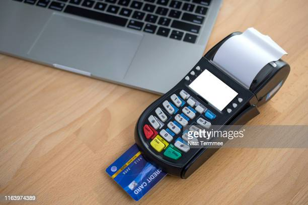 credit card over edc machine or credit card terminal. credit card payment, buy and sell products & service for sale in store. - money transfer stock pictures, royalty-free photos & images