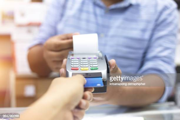 credit card payment, buy and sell products & service,redit card,redit card machine - commercial event stock photos and pictures