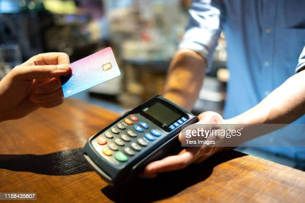credit card payment machine - suit stock pictures, royalty-free photos & images