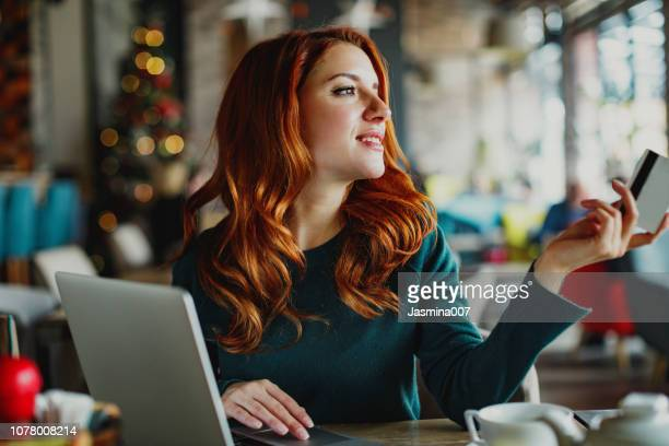 credit card payment - ginger banks stock photos and pictures