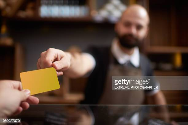 credit card payment - passing giving stock pictures, royalty-free photos & images