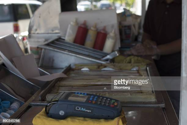 A credit card reader sits on the counter of a hot dog stand in the Chacao district of Caracas Venezuela on Wednesday Dec 6 2017 Venezuelan President...
