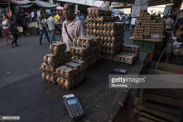 A credit card reader sits on the table at an egg stand inside a market in Petare Miranda state Venezuela on Wednesday Dec 6 2017 Venezuelan President...