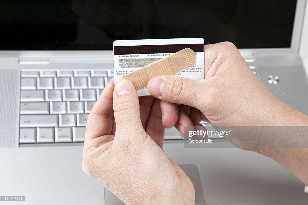 Gordons Credit Card >> Credit Card With Bandaid Stock Photo Getty Images