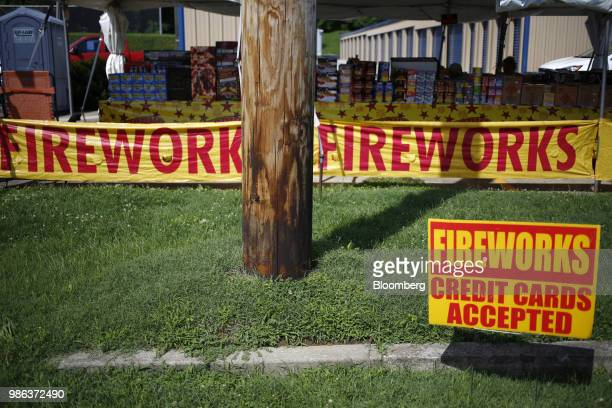 A 'Credit Cards Accepted' sign displayed outside a roadside fireworks tent in Catlettsburg Kentucky US on Thursday June 28 2018 According to the...